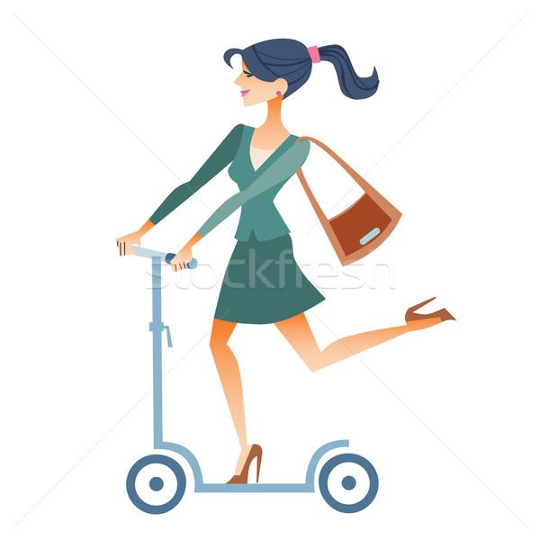 Businesswomen scooter rides to work Stock photo © studiostoks