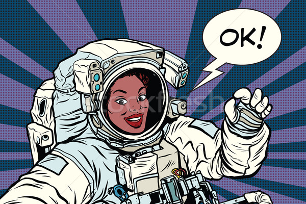 OK gesture woman astronaut in a spacesuit Stock photo © studiostoks