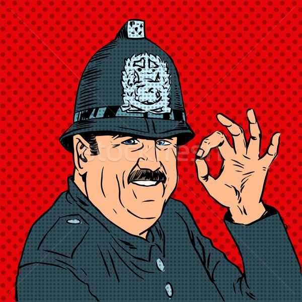 Angol rendőr egyenruha sisak kézmozdulat ok Stock fotó © studiostoks