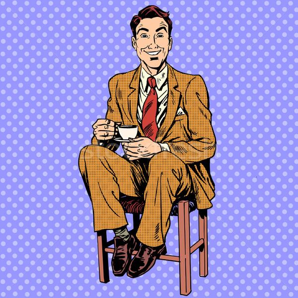 Man drinking tea sitting on the stool Stock photo © studiostoks