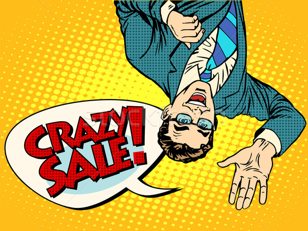 Crazy sale announcement man upside down Stock photo © studiostoks