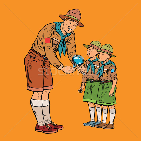 scoutmaster shows little insect to young scouts Stock photo © studiostoks