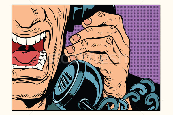 Angry man talking on the phone Stock photo © studiostoks