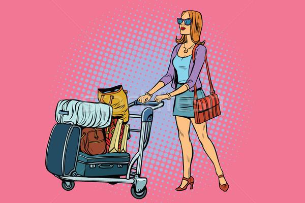 Woman tourist with Luggage cart Stock photo © studiostoks