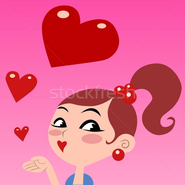 The girl gives kisses, flying red heart  Stock photo © studiostoks