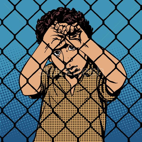 Gyermek fiú menekült mögött rácsok börtön Stock fotó © studiostoks