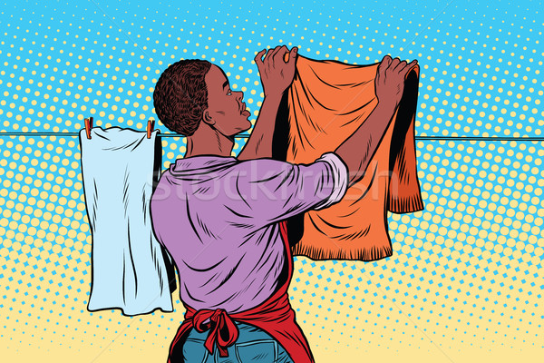 Vintage employee hangs up to dry clothes Stock photo © studiostoks