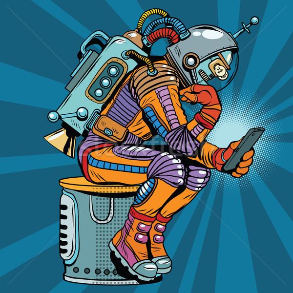Retro robot astronaut denker pose smartphone Stockfoto © studiostoks