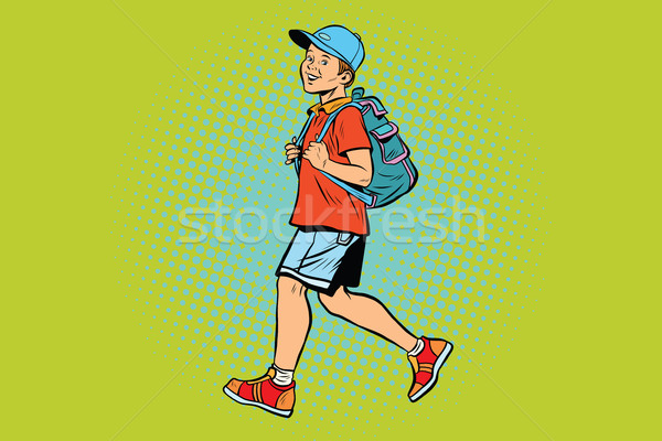 Boy student with a backpack goes to school or Hiking Stock photo © studiostoks