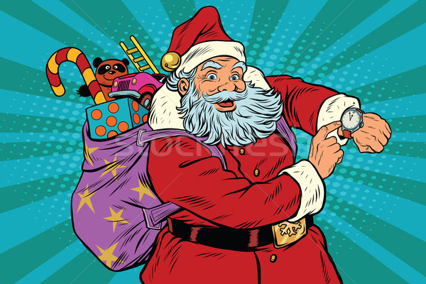 Santa Claus shows on the clock, New year and Christmas Stock photo © studiostoks