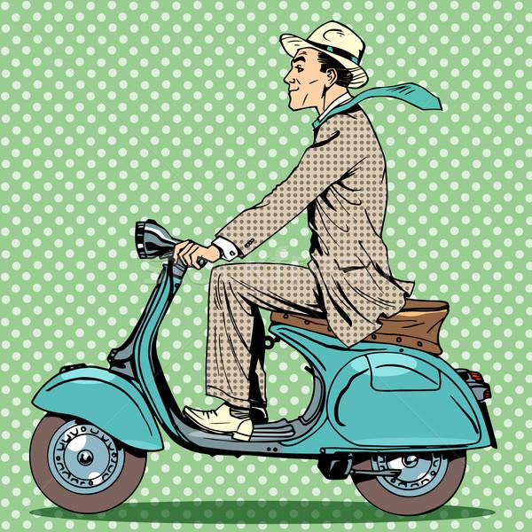 man rides on a vintage scooter Stock photo © studiostoks