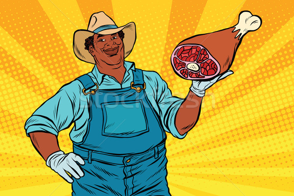 African American farmer with meat foot Stock photo © studiostoks
