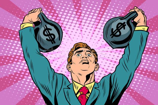 Businessman strongman lifts weights money Stock photo © studiostoks