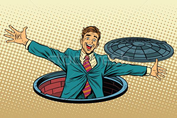 joyful man in the manhole Stock photo © studiostoks