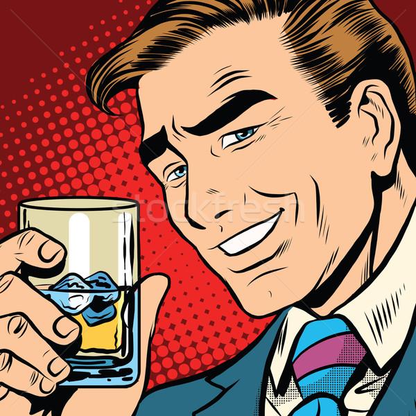 Toast cheers whisky with ice, elegant man Stock photo © studiostoks