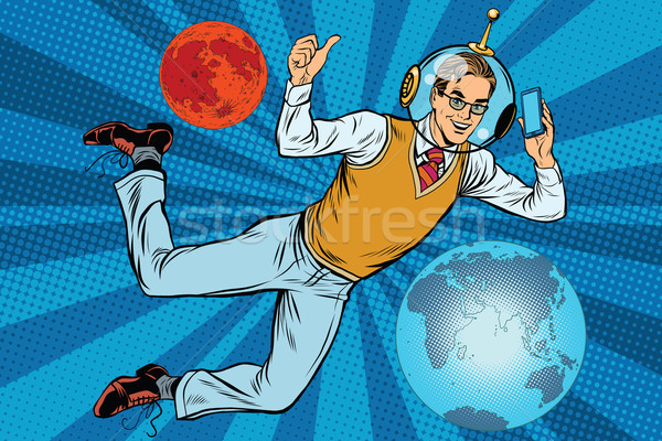Space businessman with smartphone over the planet Earth and Mars Stock photo © studiostoks