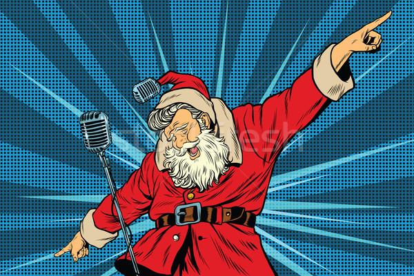 Santa Claus superstar singer on stage Stock photo © studiostoks