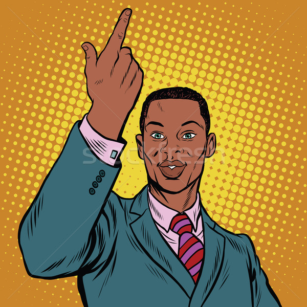 African American businessman pointing finger up Stock photo © studiostoks