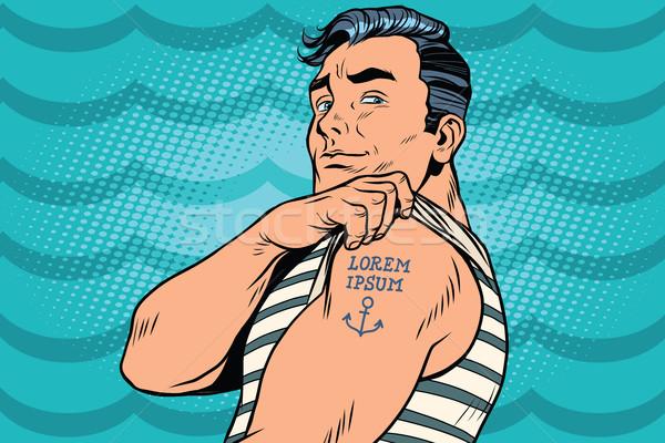 Sailor with Lorem ipsum tattoo on hand Stock photo © studiostoks