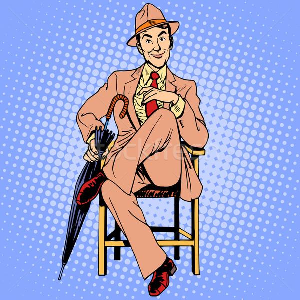 Elegante uomo ombrello seduta sgabello bellezza Foto d'archivio © studiostoks