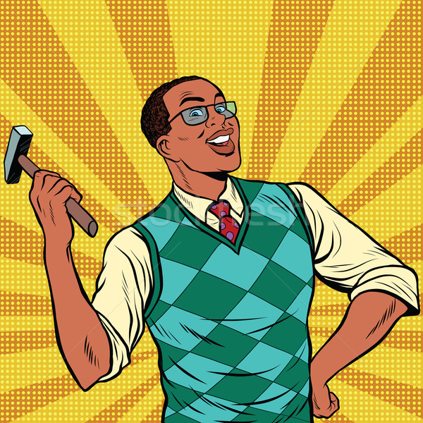 Retro man with a hammer for home repairs Stock photo © studiostoks