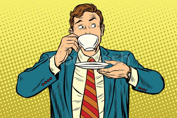 Businessman drinking Cup of coffee looking sideways Stock photo © studiostoks