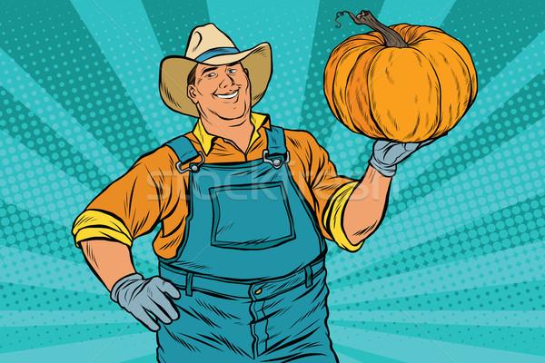 Rural farmer and pumpkin, holiday thanksgiving Stock photo © studiostoks