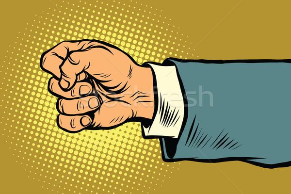 Hand of a businessman beats fist Stock photo © studiostoks