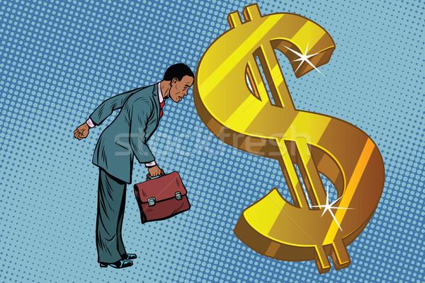 üzletember pénzügy férfi homlok dollár afroamerikai Stock fotó © studiostoks
