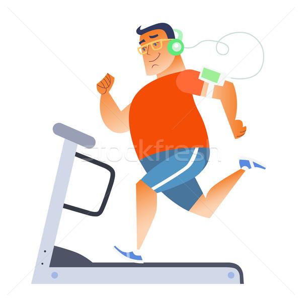 Kövér férfi mozdulatlan futópad zenét hallgat játékos Stock fotó © studiostoks