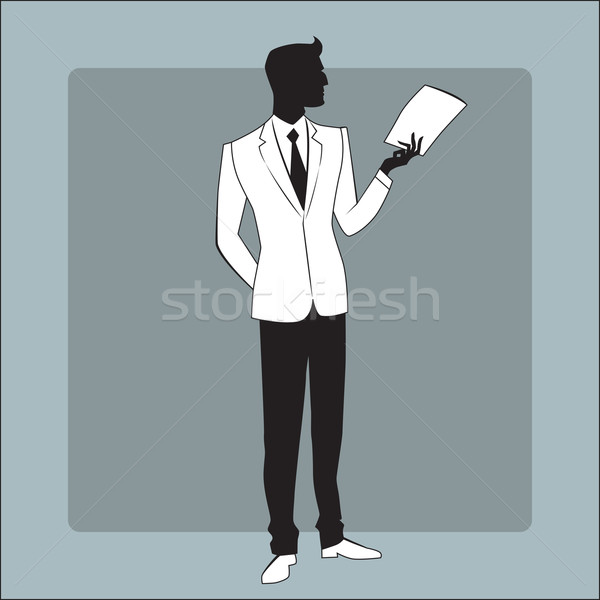 Businessman in modern clothes reads the report Stock photo © studiostoks