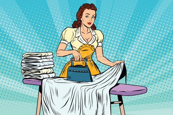 The hotel maid iron irons linen Stock photo © studiostoks