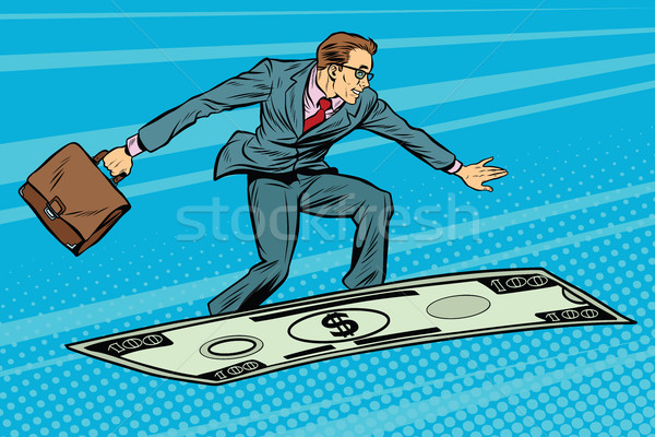 Businessman on flying money carpet plane Stock photo © studiostoks