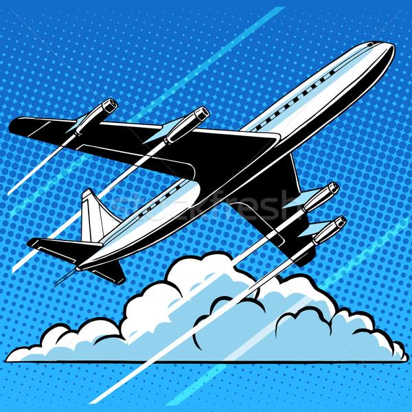 Passenger airplane in the clouds retro background Stock photo © studiostoks