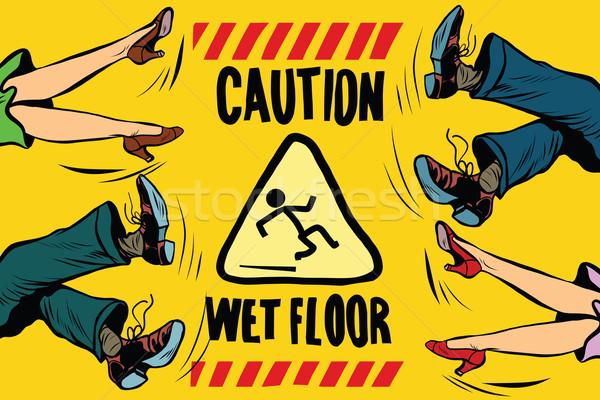 caution wet floor, feet of women and men Stock photo © studiostoks