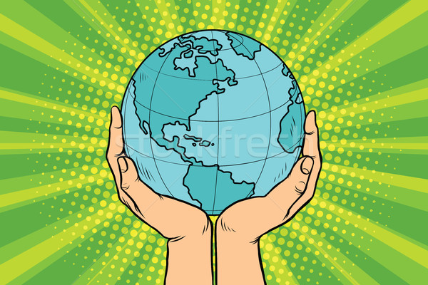 Blue planet Earth in human hands Stock photo © studiostoks