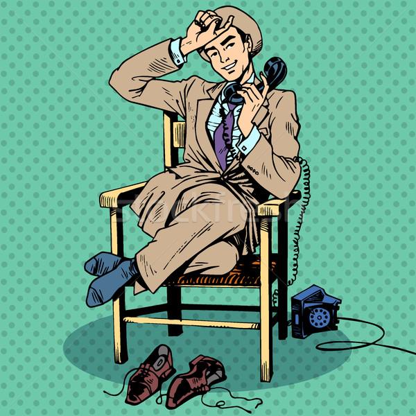 Tired man sits chair talking phone Stock photo © studiostoks