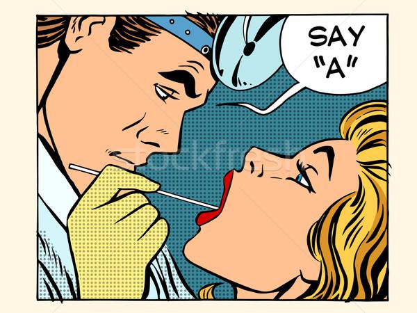 otolaryngologist examines the throat patient  Stock photo © studiostoks