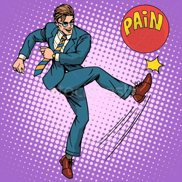 Man hits ball with name pain Stock photo © studiostoks