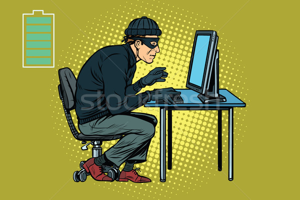 Caucasian hacker thief hacking into a computer Imagine de stoc © studiostoks
