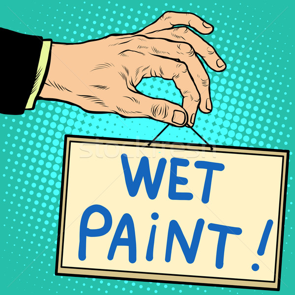 Hand holding a sign wet paint  Stock photo © studiostoks