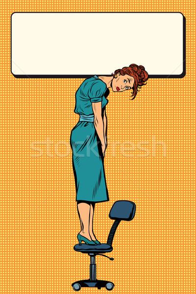 Empresária em pé cadeira assinar Foto stock © studiostoks