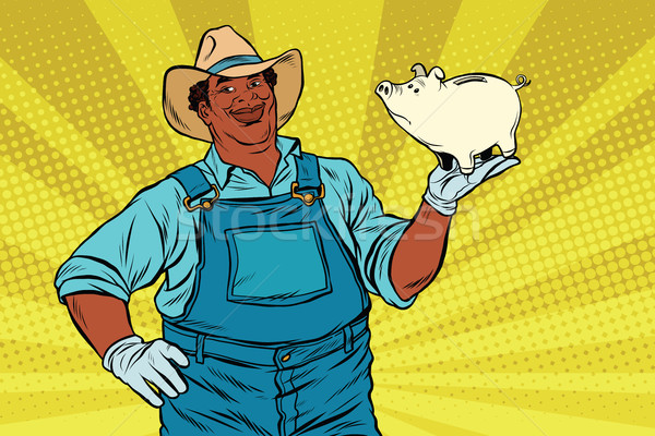 African American farmer with a pig-piggy Bank Stock photo © studiostoks