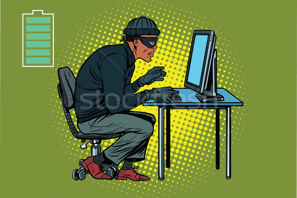 African hacker thief hacking into a computer Stock photo © studiostoks