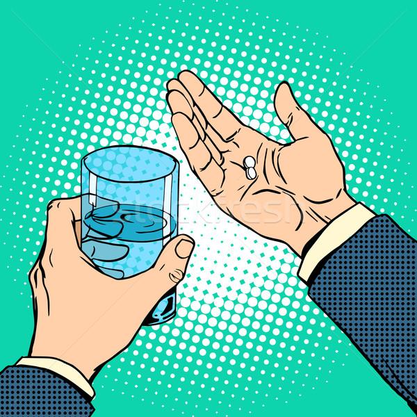 Médication santé pilules main verre eau Photo stock © studiostoks
