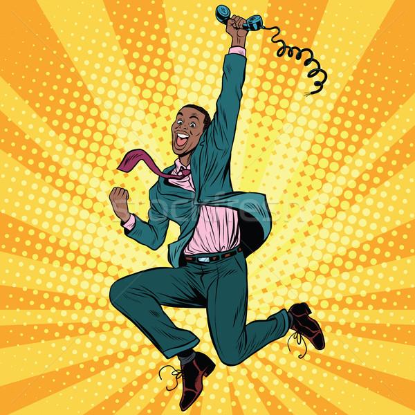 Businessman with phone jump happiness emotions Stock photo © studiostoks
