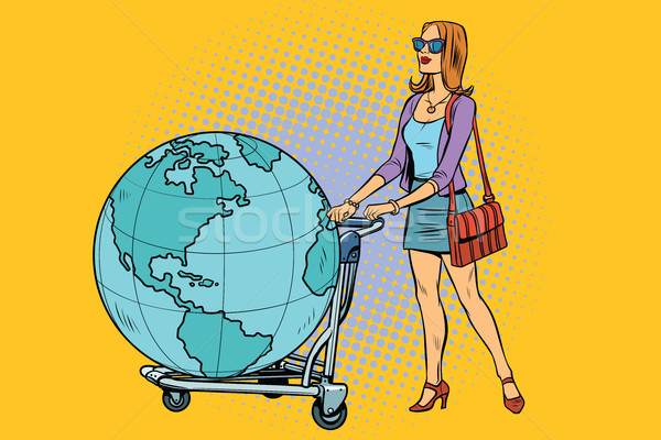 Woman tourist with a Luggage cart with the planet Earth Stock photo © studiostoks