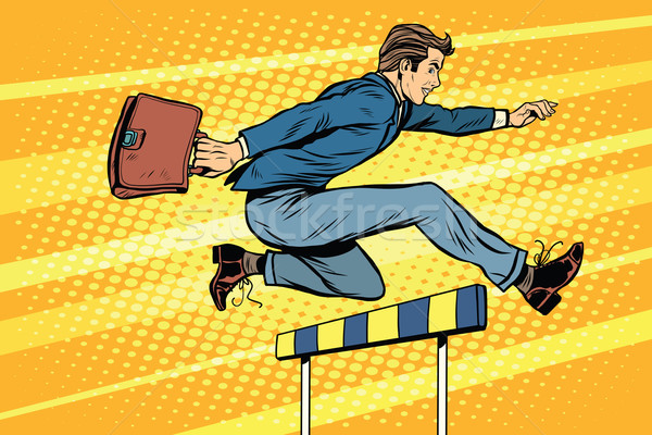 Businessman running hurdles Stock photo © studiostoks