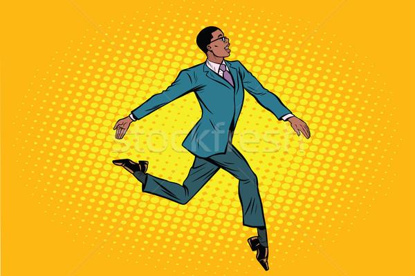 African businessman runs forward elegantly Stock photo © studiostoks