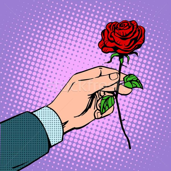 man gives flower rose Stock photo © studiostoks